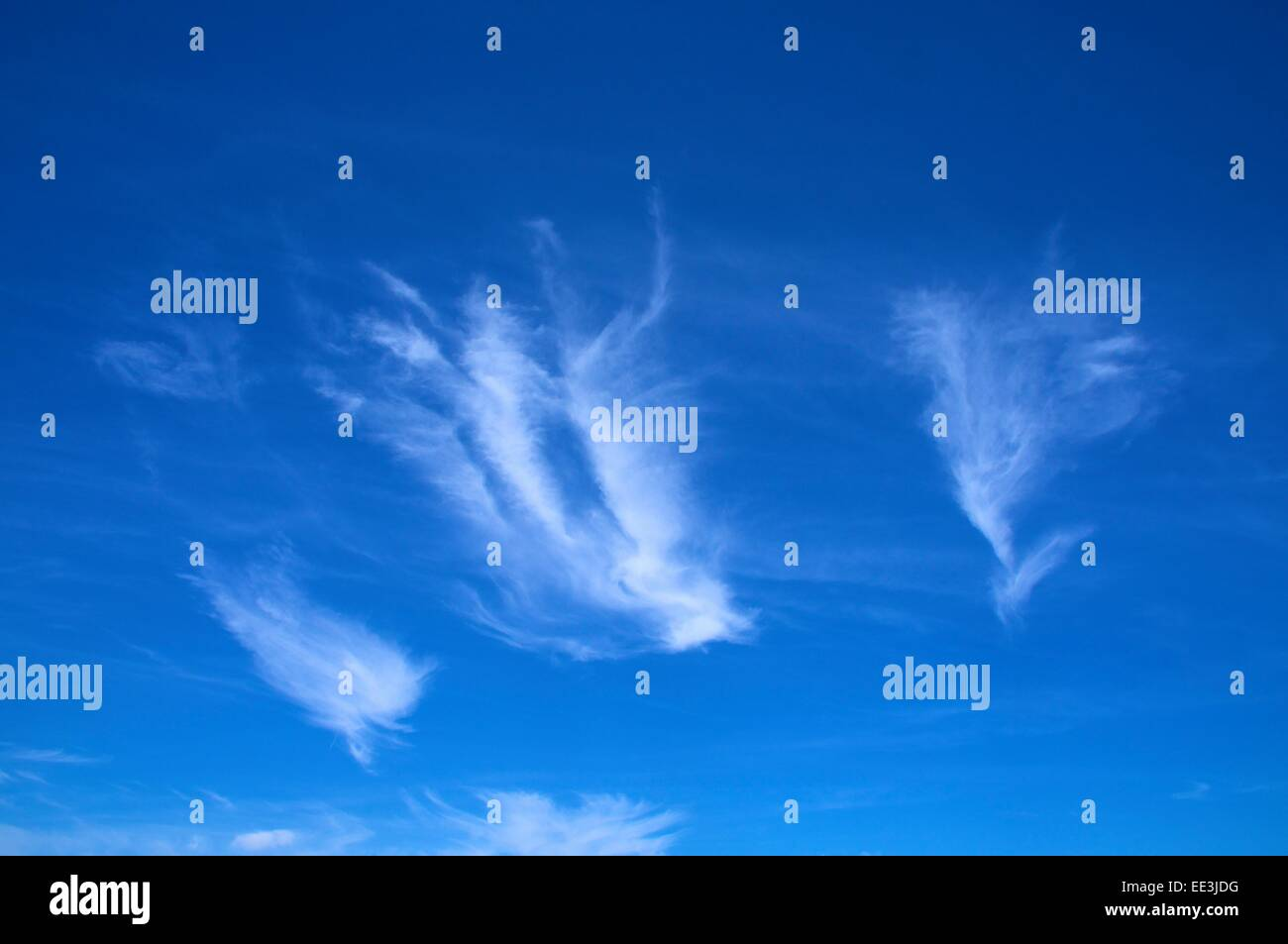 Cirrus clouds in blue sky. - Stock Image