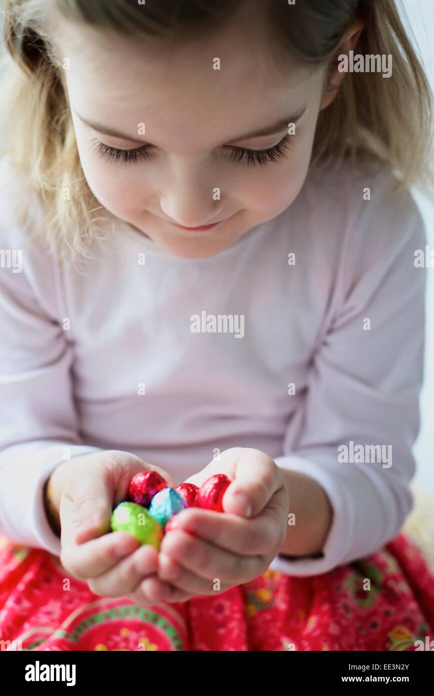 Liitle girl gathering Easter eggs, close-up - Stock Image