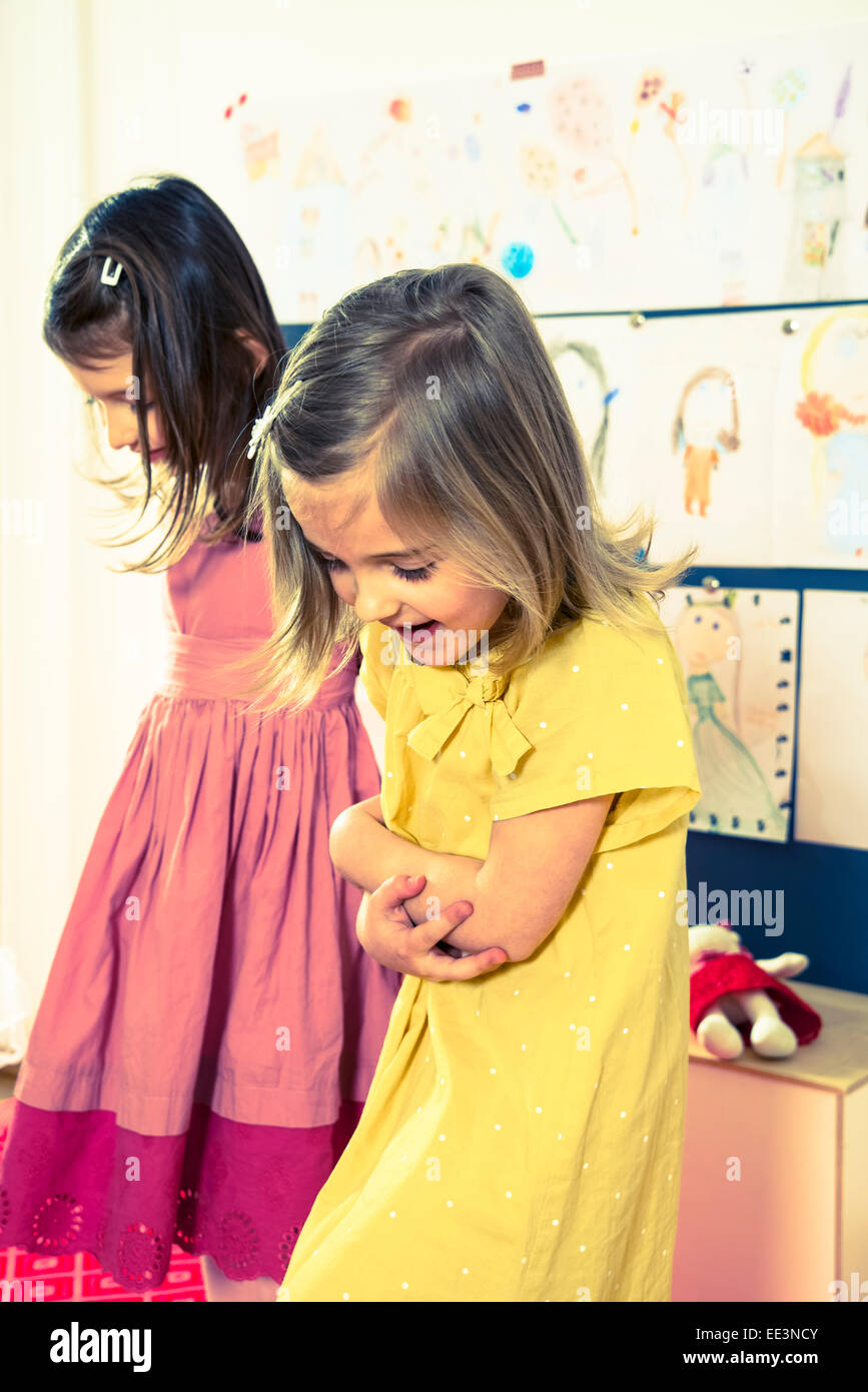 Two girls playing in nursery - Stock Image