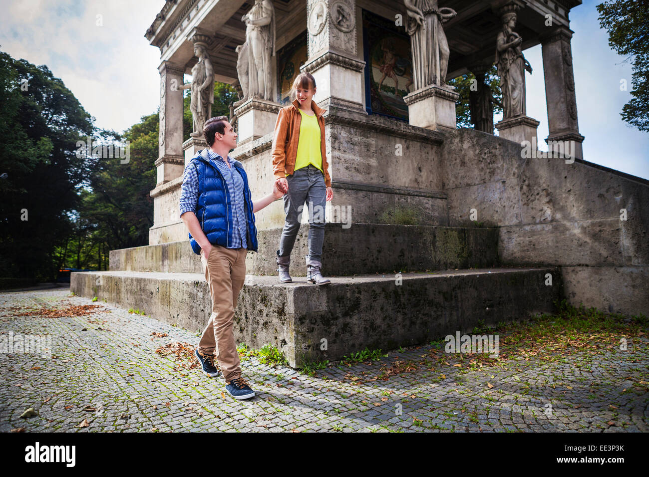 Young couple by Angel of Peace Monument, Munich, Bavaria, Germany - Stock Image