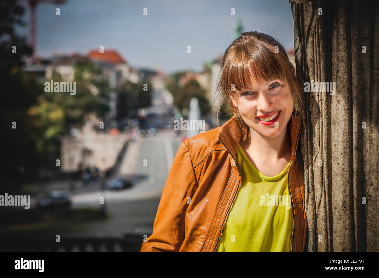 Portrait of young woman outdoors, Munich, Bavaria, Germany - Stock Image