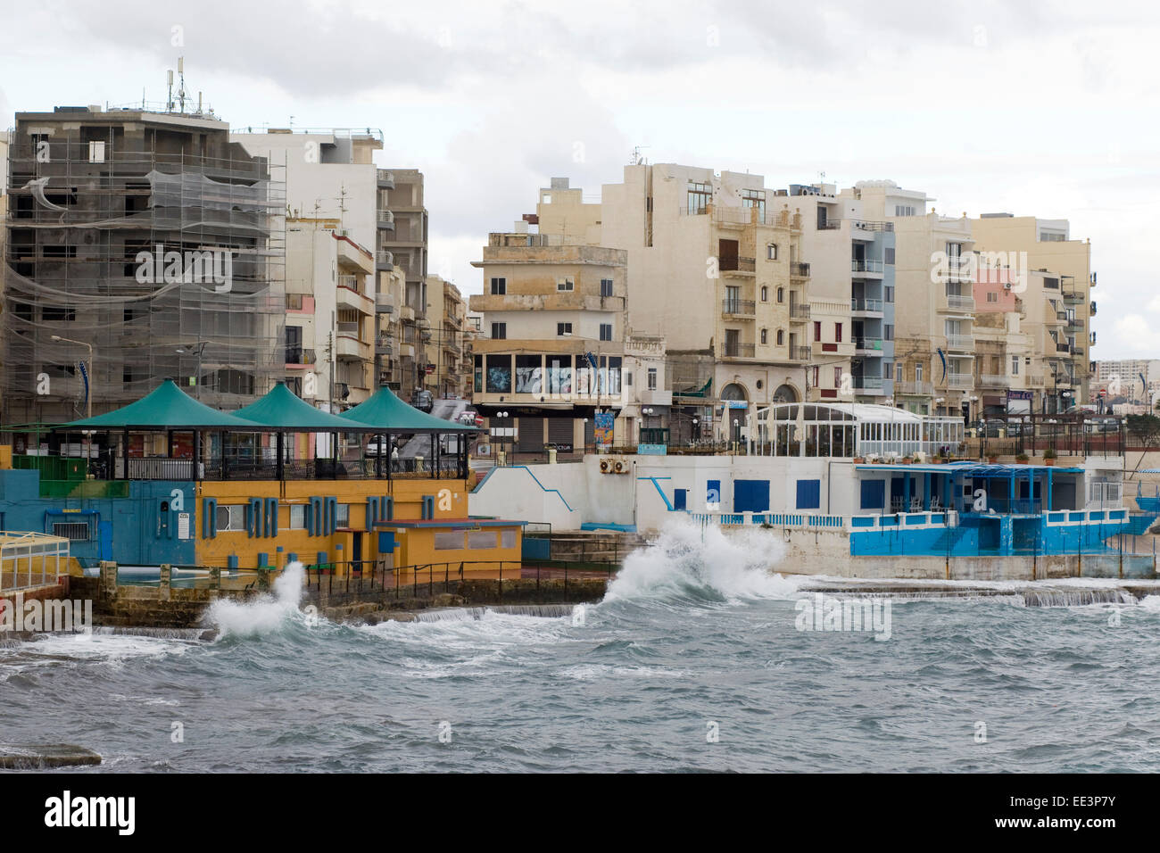 Waves crashing in the surf damaging and flooding local area in Malta - Stock Image