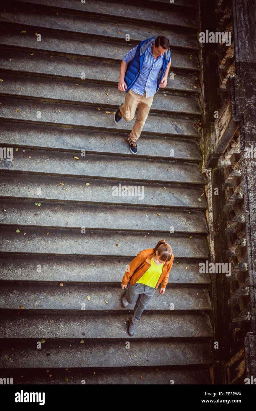 Young couple walking down steps, Munich, Bavaria, Germany Stock Photo