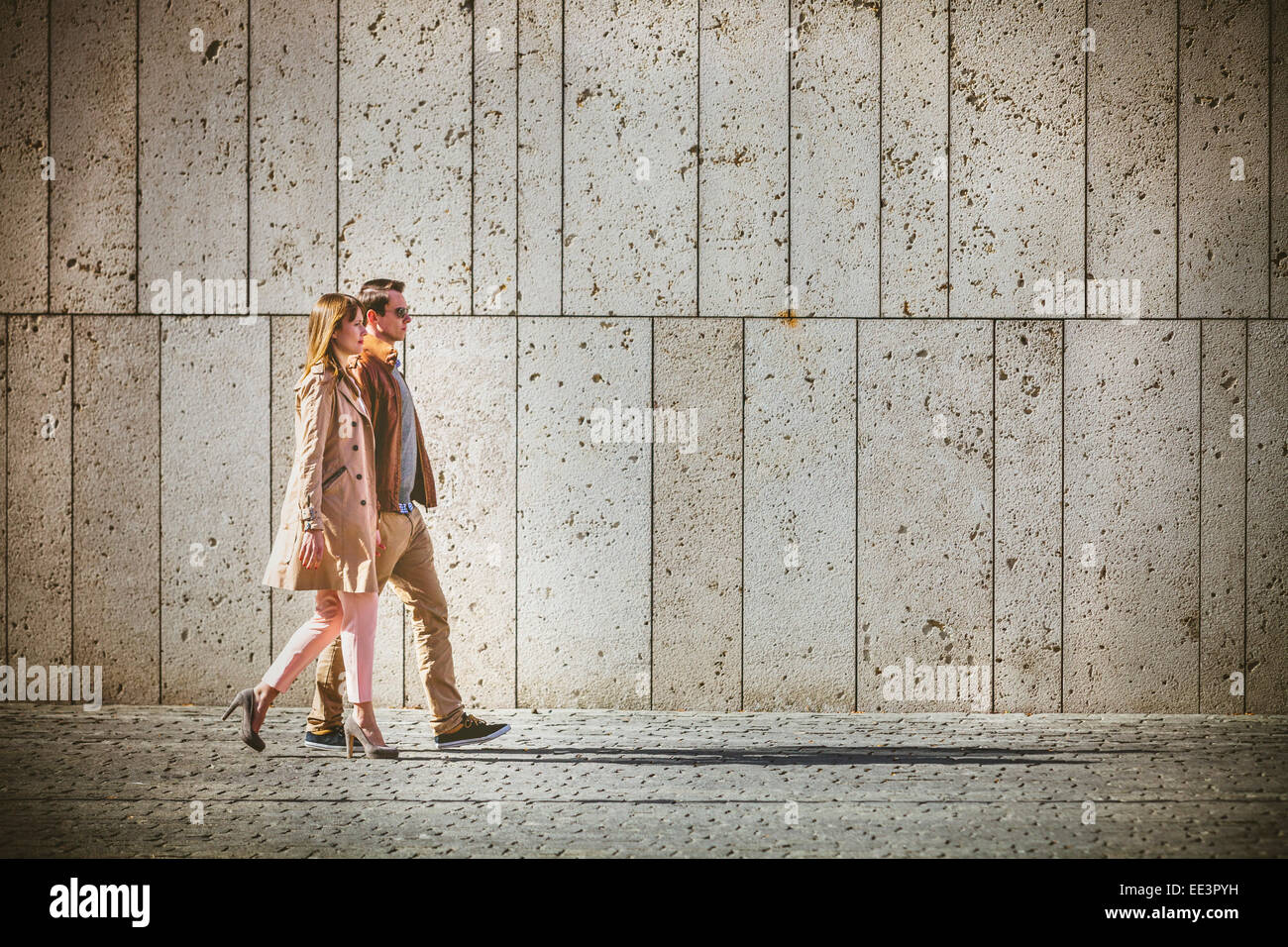 Young couple walking through Old Town, Munich, Bavaria, Germany - Stock Image