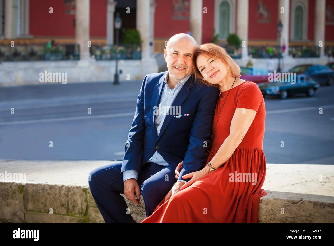 Happy senior couple sitting side by side outdoors, Munich, Bavaria, Germany - Stock Image