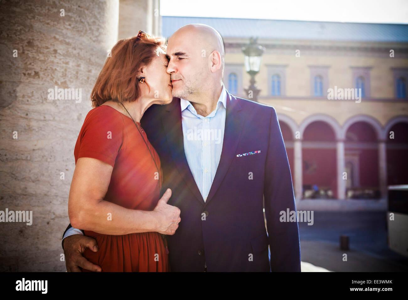 Senior couple kissing tenderly, Munich, Bavaria, Germany - Stock Image