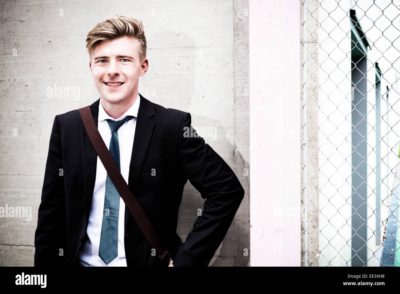 Portrait of young businessman, Munich, Bavaria, Germany - Stock Image