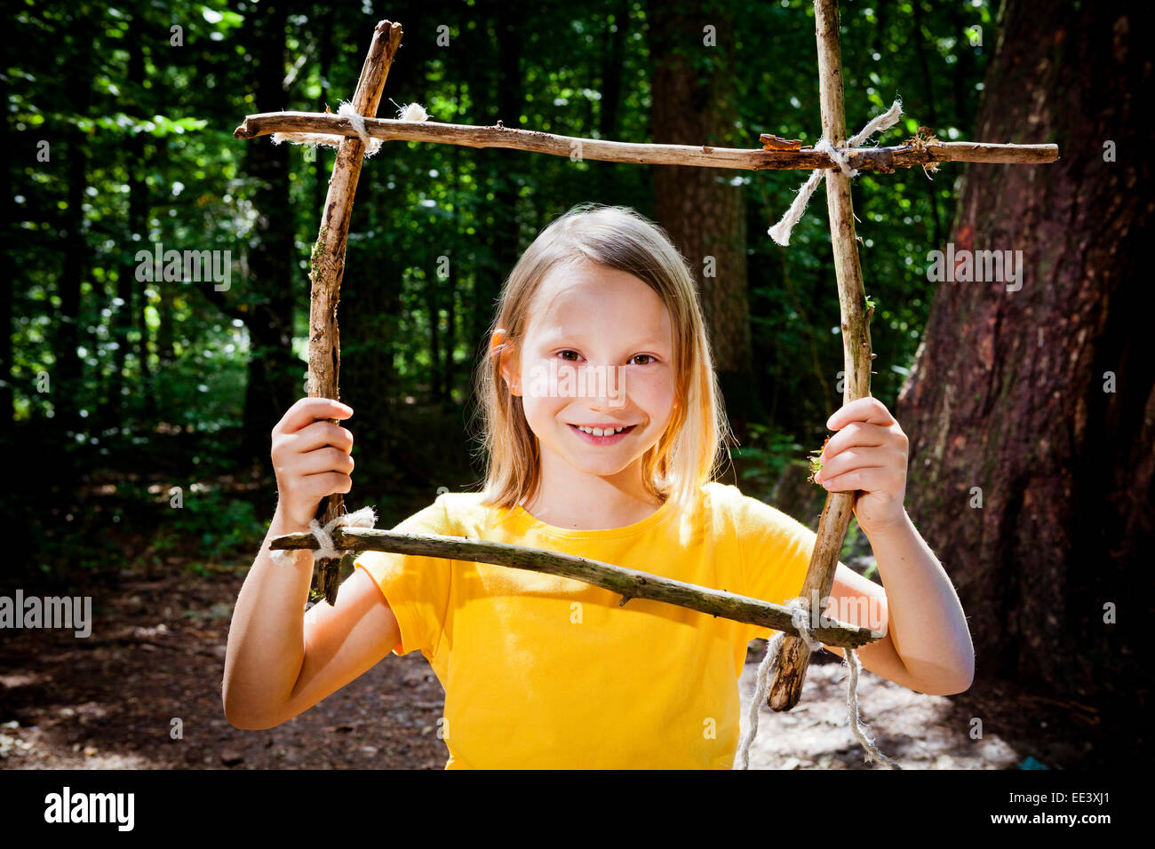 Girl crafting in a forest camp, Munich, Bavaria, Germany Stock Photo