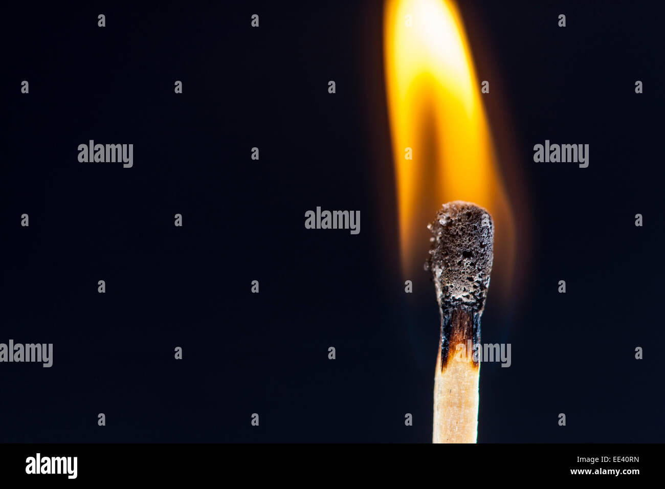 Match, just ignited flame at the match head, - Stock Image