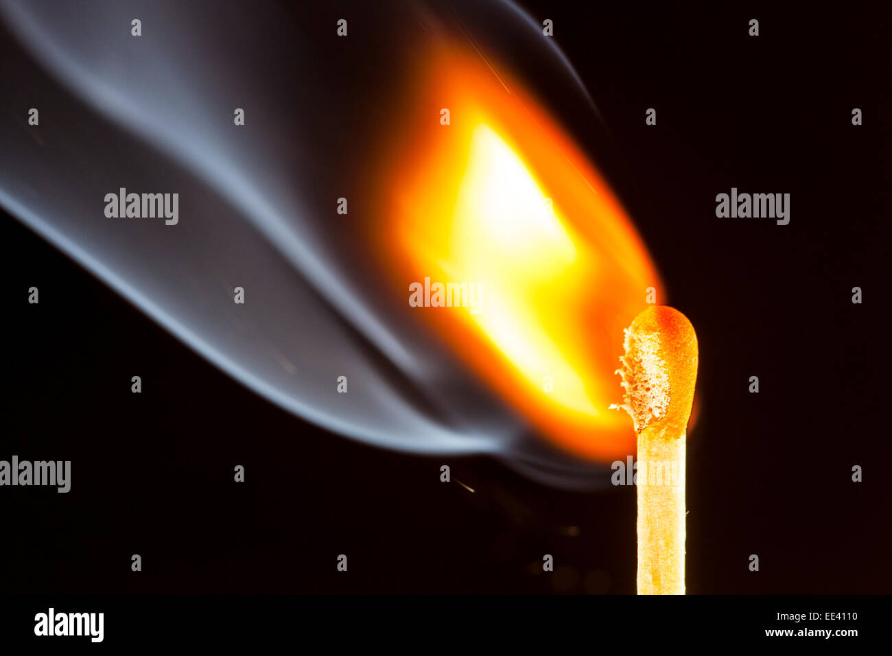 Match just ignited, flame at the match head, - Stock Image