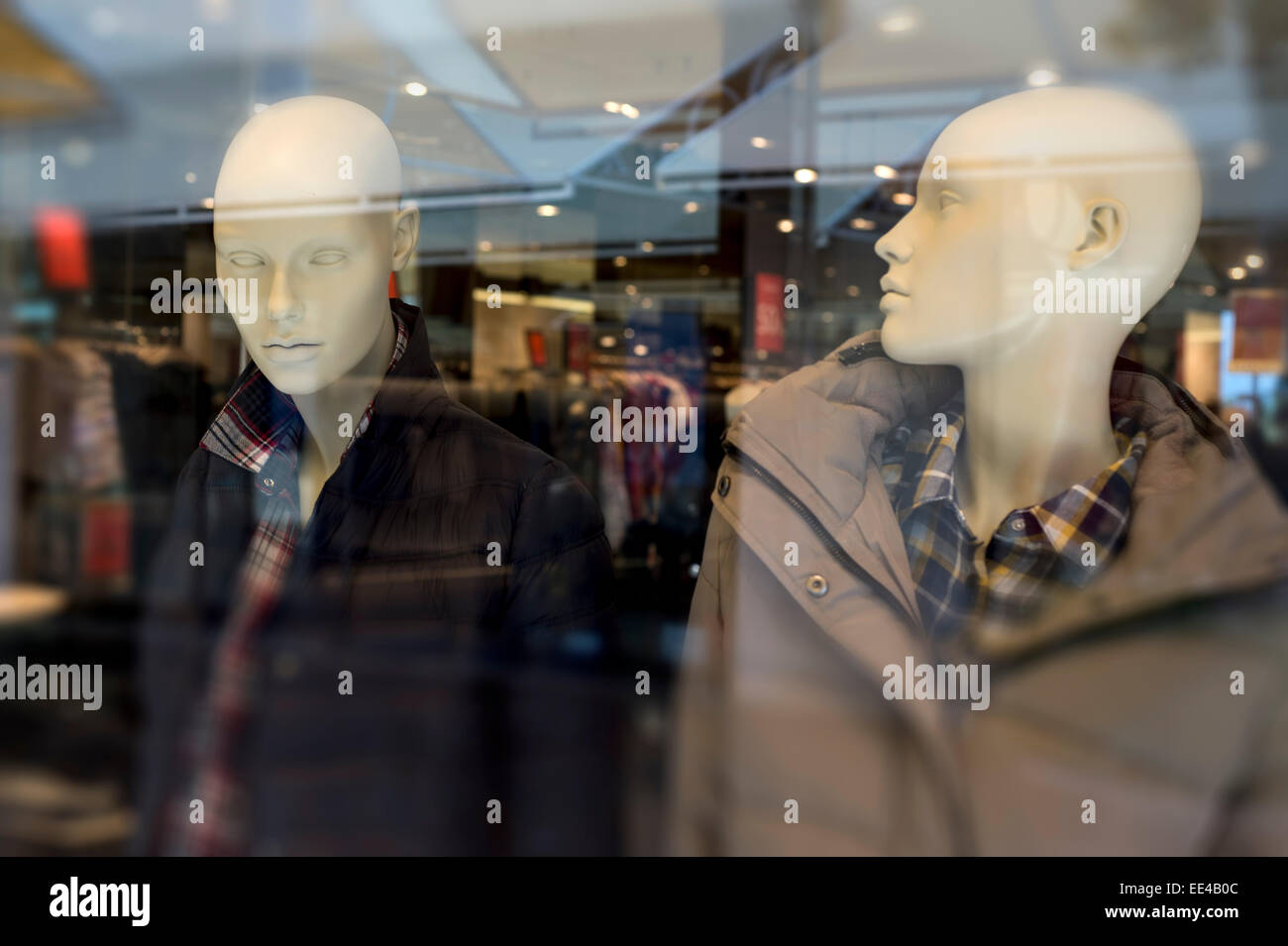two male mannequins in shop window in Portugal - Stock Image