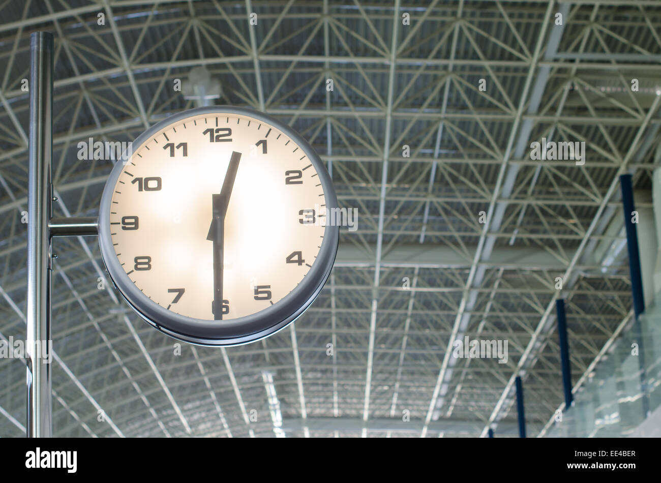The airport clock marks the time of shipment - Stock Image
