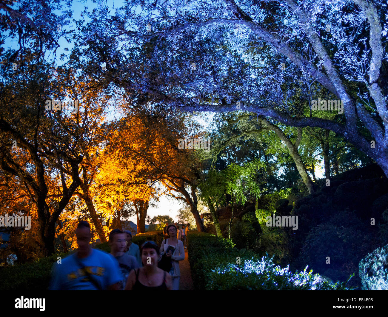 Visitors to a candlelight night at the gardens of Chateau Marqueyssac walk through the illuminated parks at dusk. - Stock Image