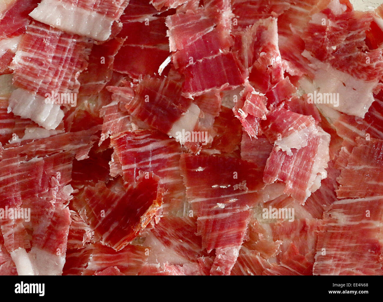 Traditionally Spanish Iberic ham (made of cured pork meat) - Stock Image