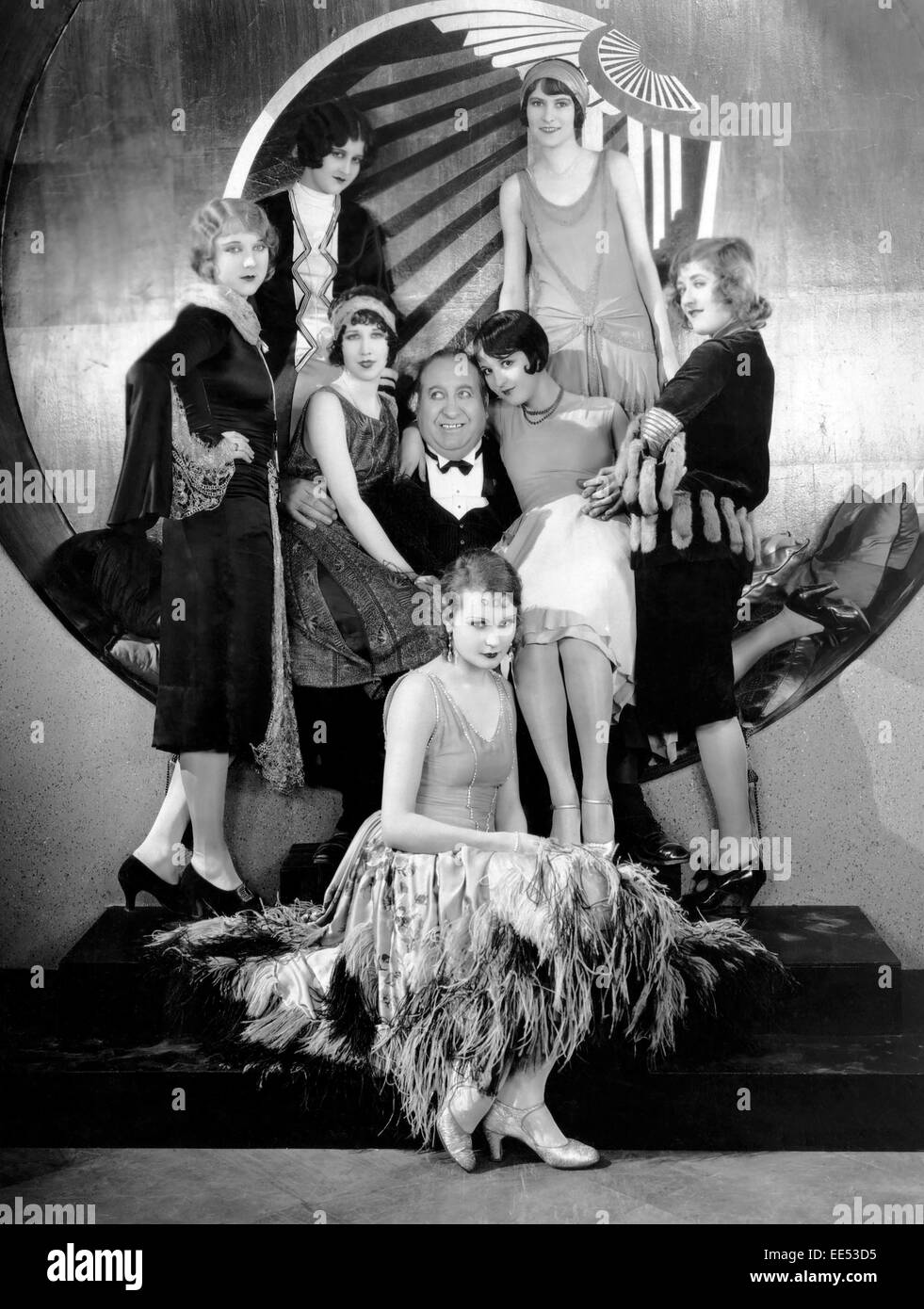 """Mack Swain, surrounded by Chorus Girls, on-set of the Silent Film, """"Becky"""", 1927 Stock Photo"""