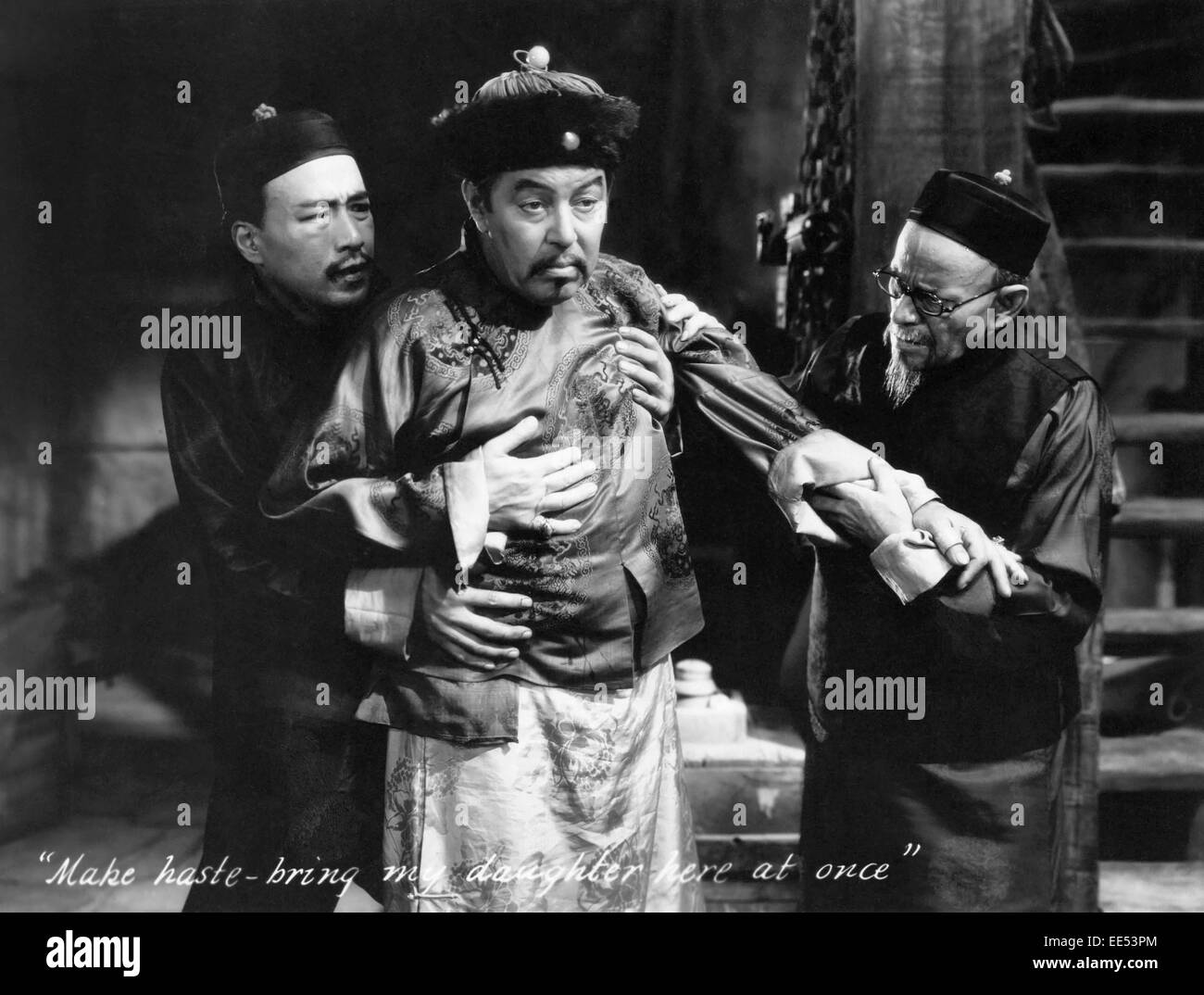 Sessue Hayakawa, (left), Warner Oland, (center), on-set of the Film, 'Daughter of the Dragon', 1931 - Stock Image