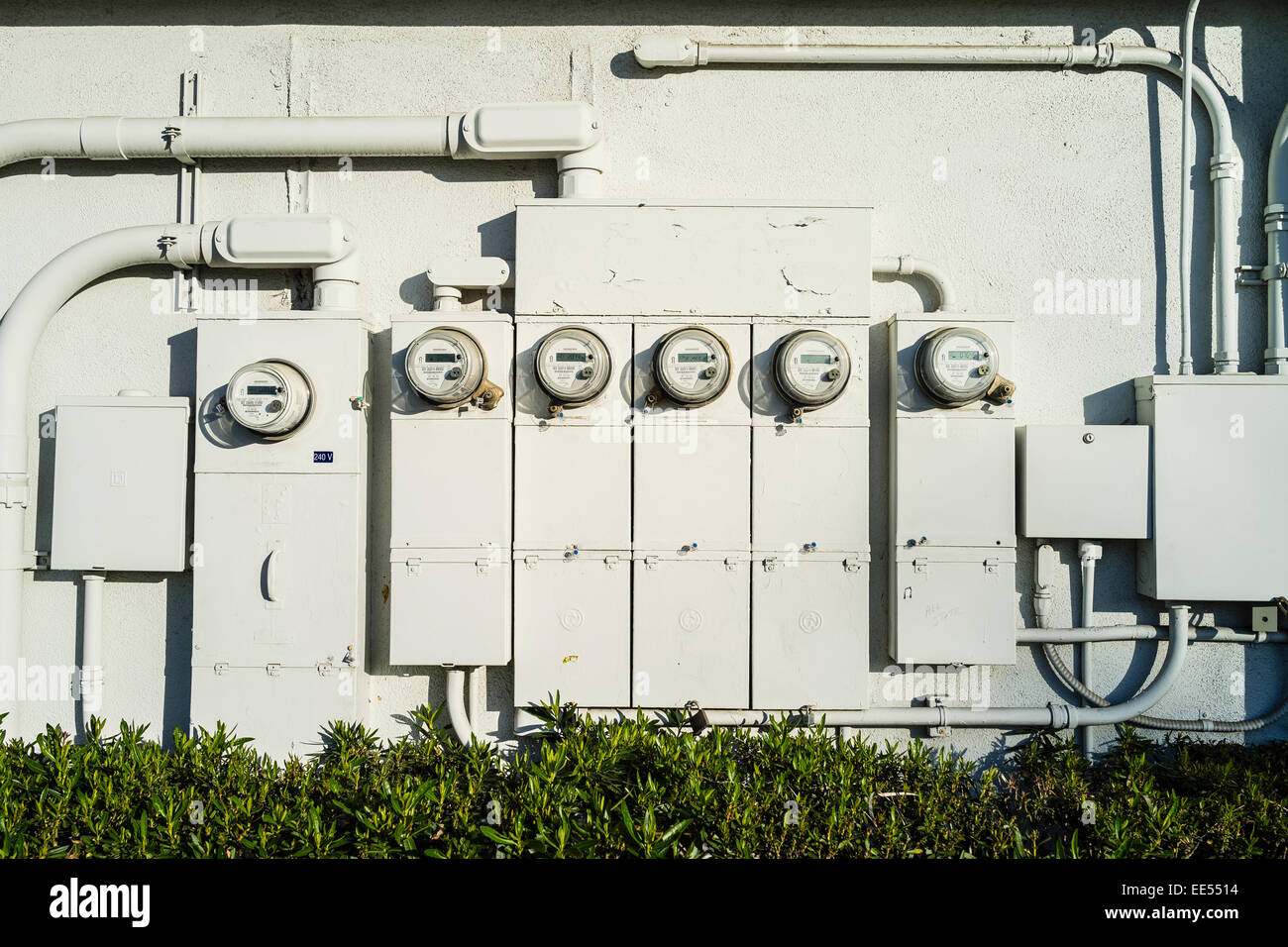 A bank of electrical meters and the conduit containing the wiring on ...