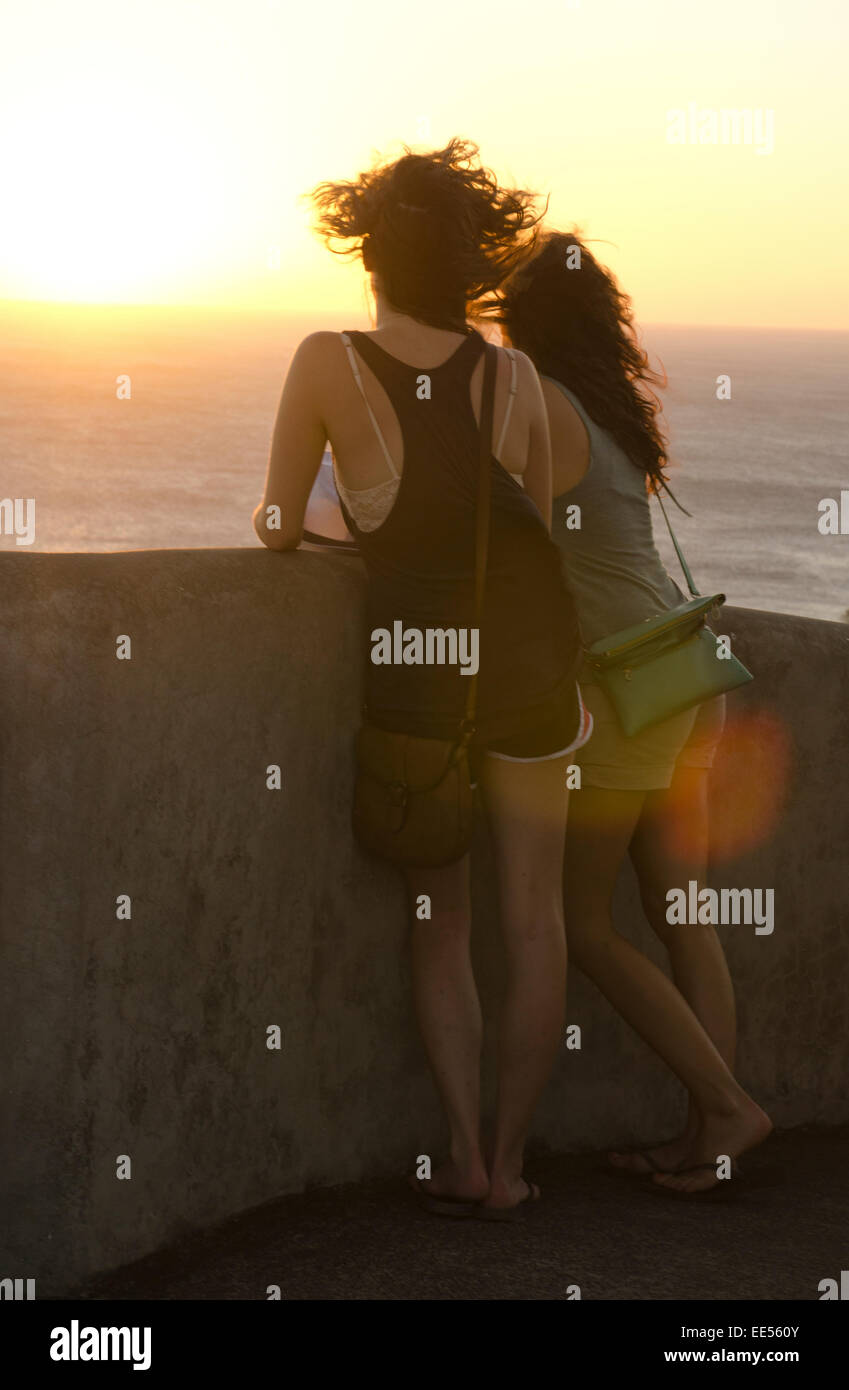 Two beautiful young womens watching the sunset in san juan del sur, nicaragua - Stock Image