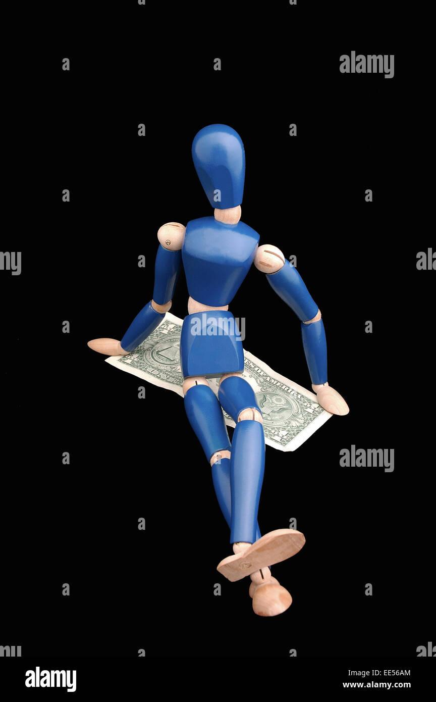 Female mannequin figure sitting across dollar bill, USD - Stock Image