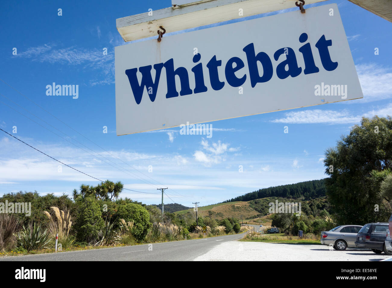 Whitebait sign at the side of the road in front of Niagara Falls Cafe restaurant in Niagara, The Catlins, New Zealand - Stock Image