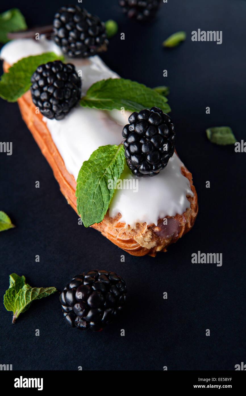 exquisite cream dessert eclair - Stock Image