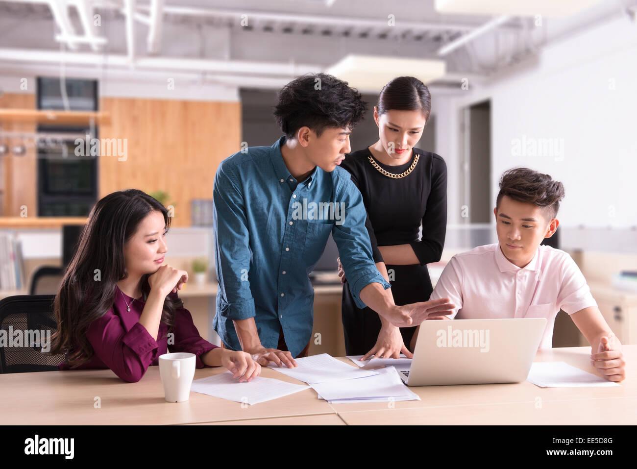Creative workers having informal meeting in office space - Stock Image