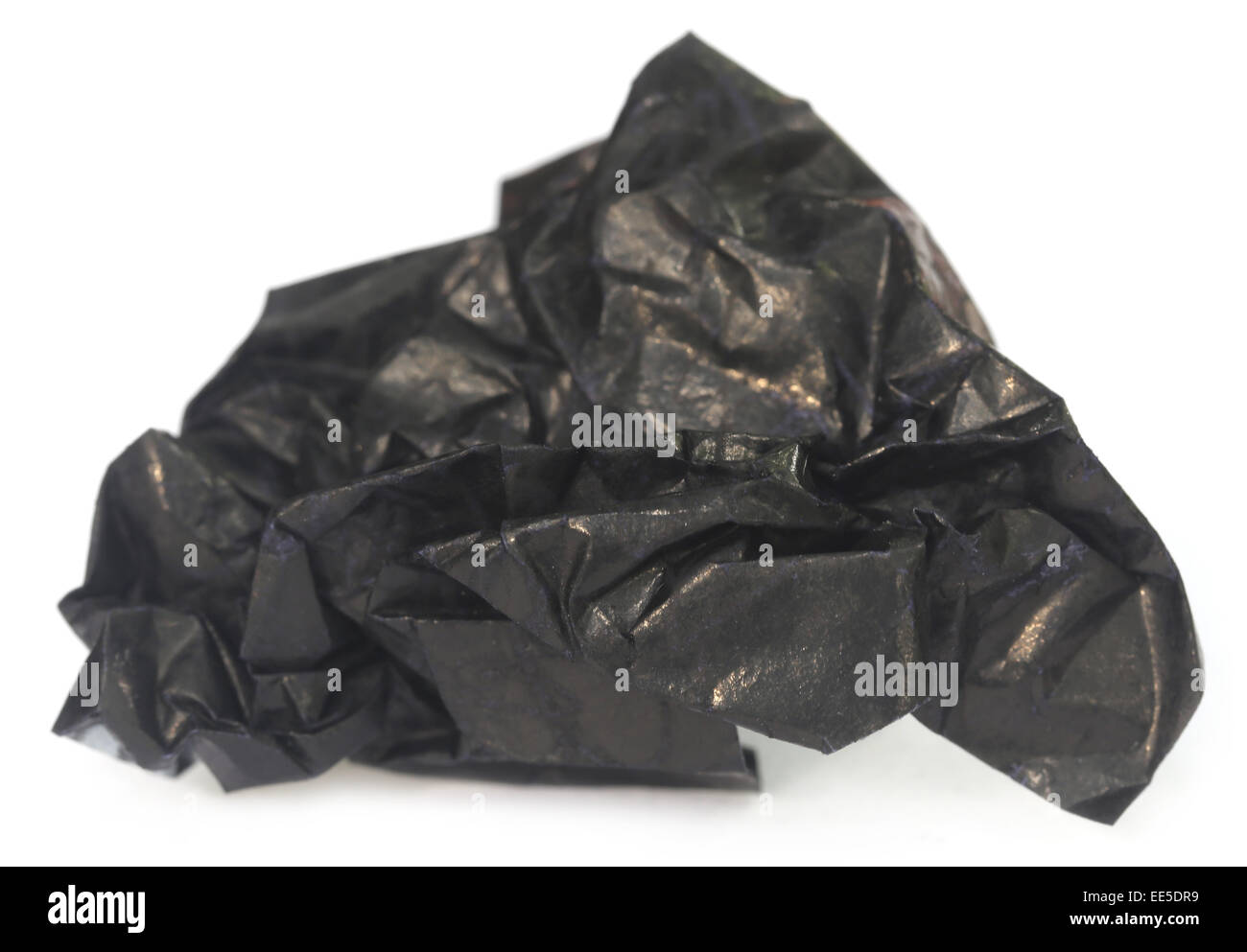 Crippled Carbon paper over white background - Stock Image