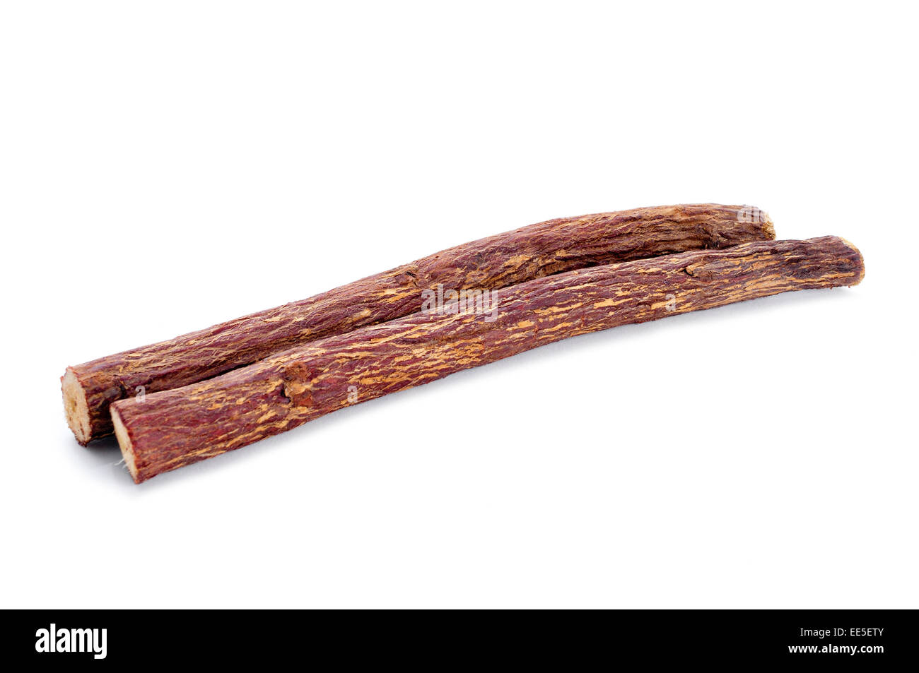 some licorice roots on a white background - Stock Image