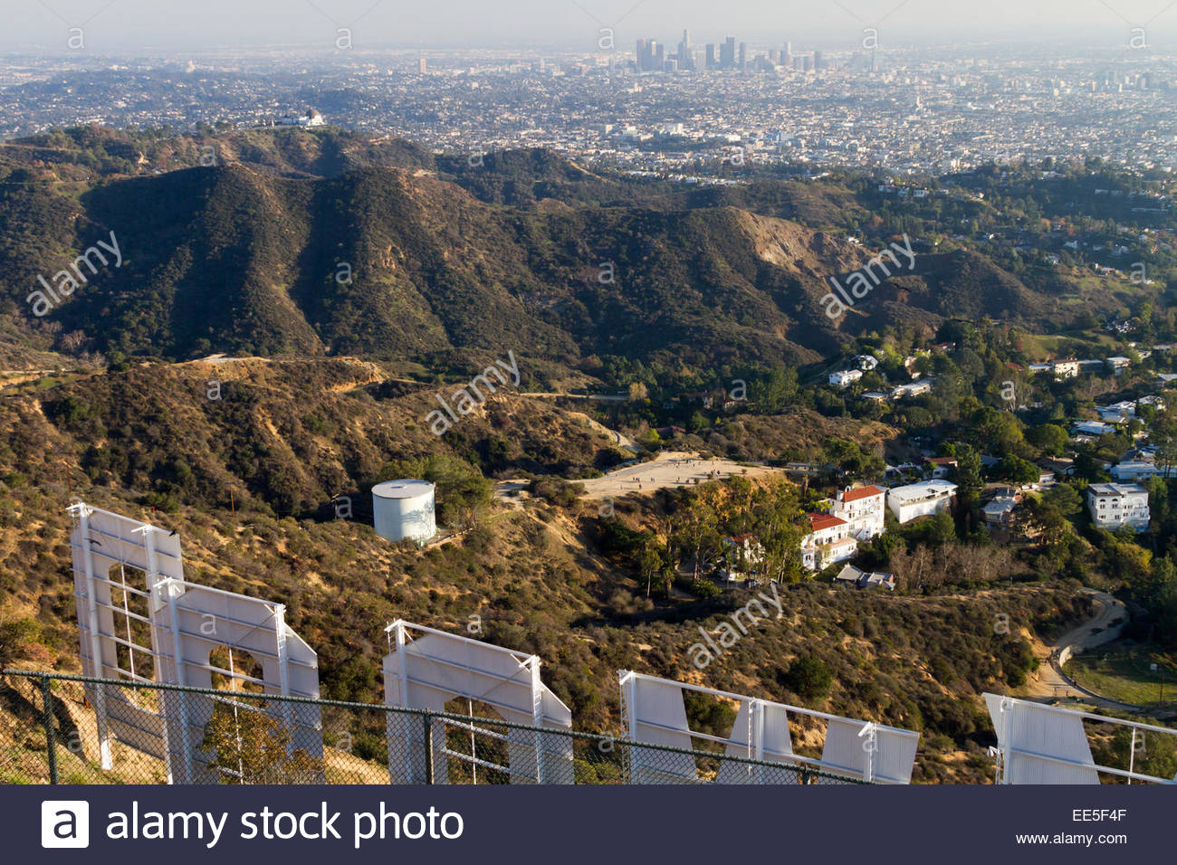 View of downtown Los Angeles with Hollywood sign in foreground - USA - California - Los Angeles - Stock Image