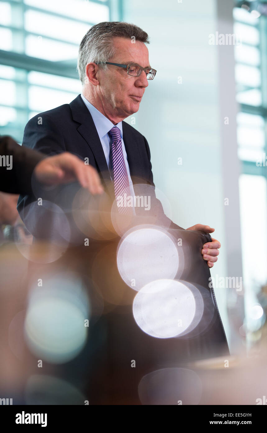 Berlin, Germany. 14th Jan, 2015. German Interior Minister Thomas de Maiziere (CDU) stands before the session of - Stock Image