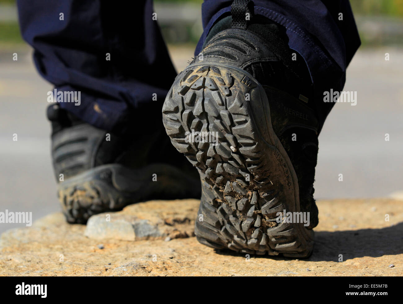 Keeping fit - healthy lifestyle - sole of muddy black walking boot close up - Stock Image