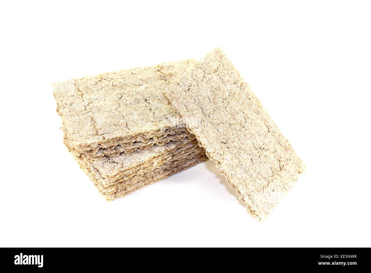 small stack of crisp crispbread on a light background - Stock Image