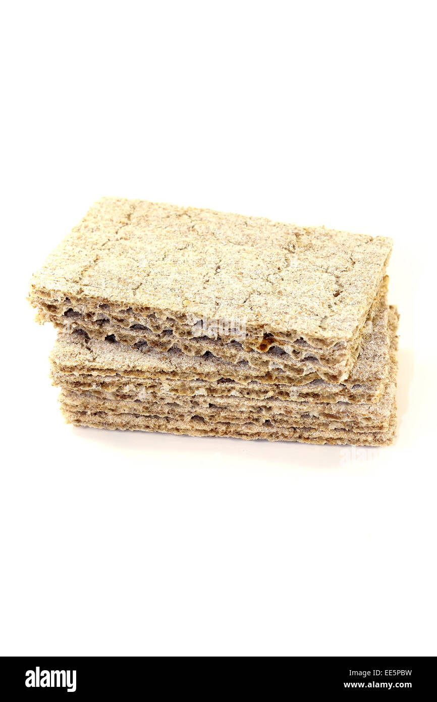 small stack of crispbread on a light background - Stock Image