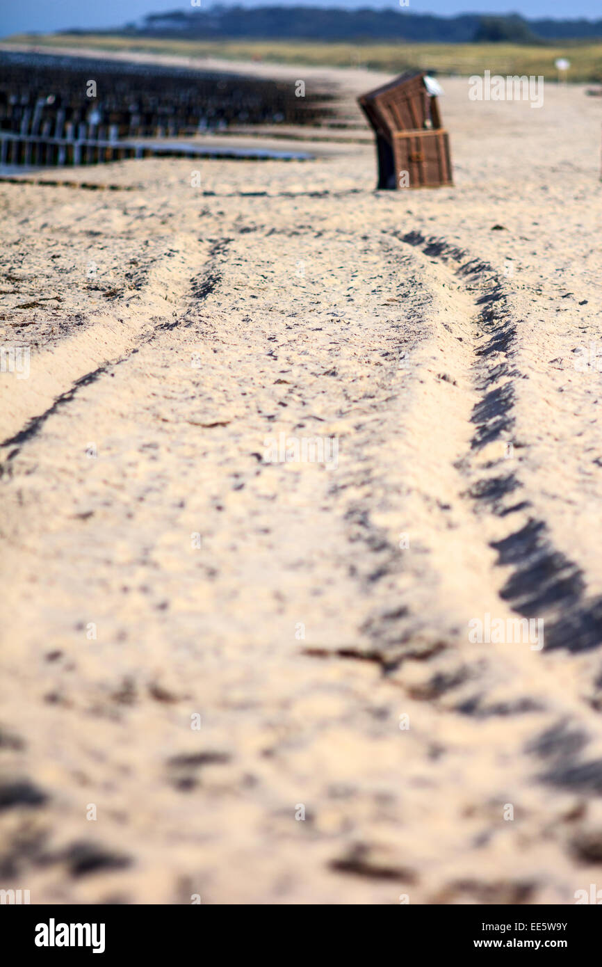 Tire tracks on a beach near Rostock, a town in northern Germany. - Stock Image