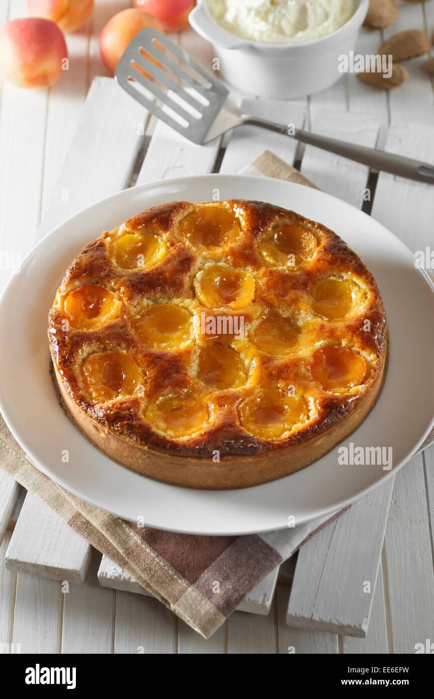 Apricot and almond tart. Tarte abricot amandine. - Stock Image