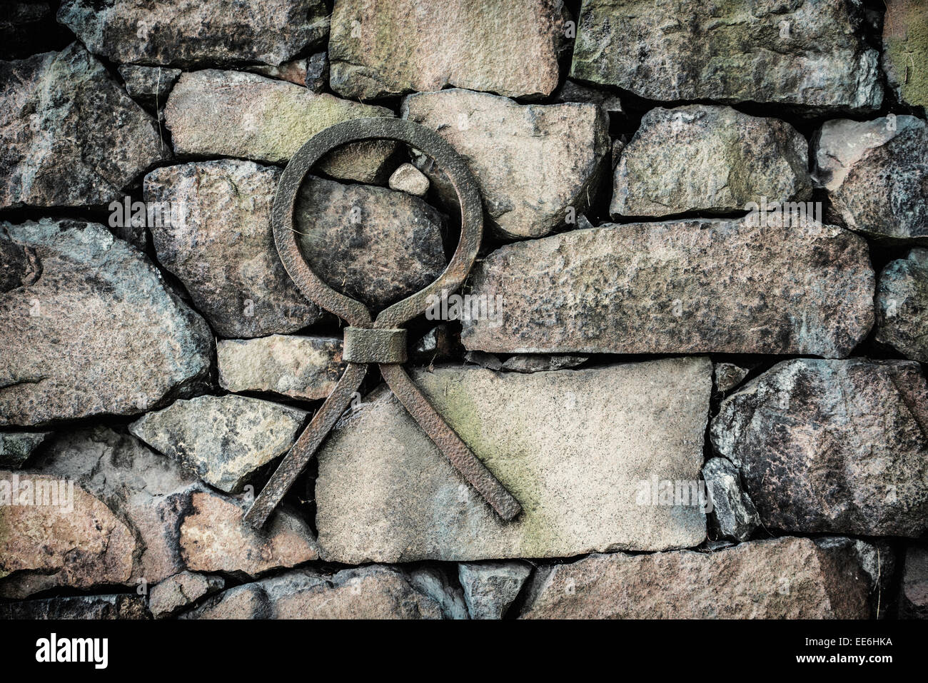 Old stone wall with iron reinforcement, Sweden - Stock Image