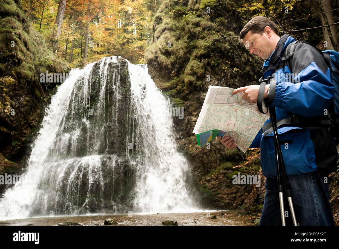 Man Reading Map, Bavaria, Germany, Europe - Stock Image