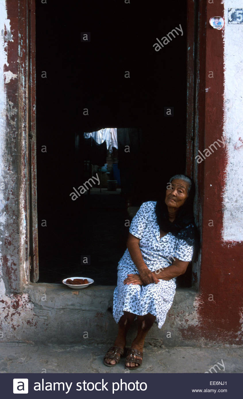 Mexcaltitan, A woman sitting in the entrance to her home - Stock Image