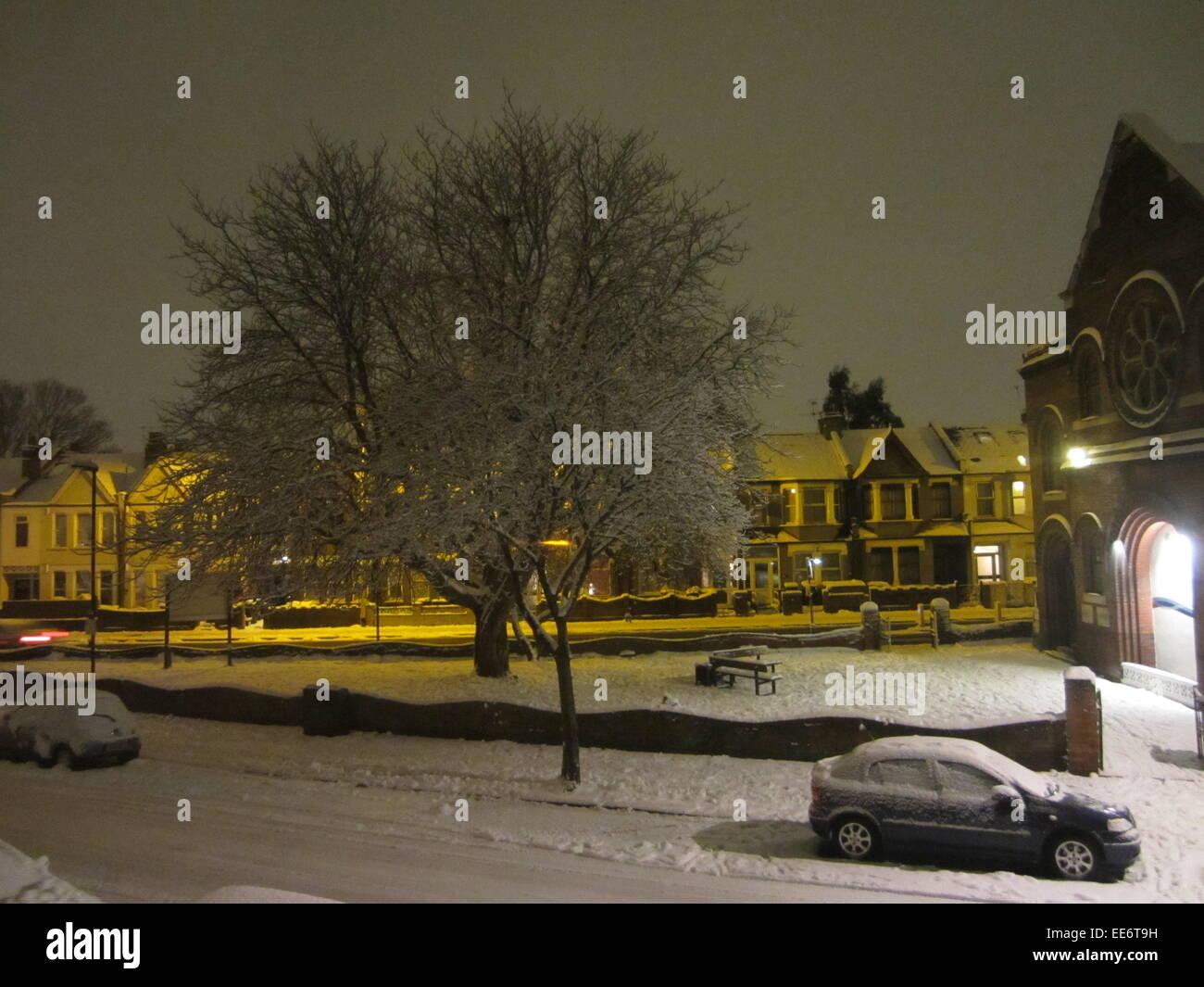 snowy london street at night haringey - Stock Image