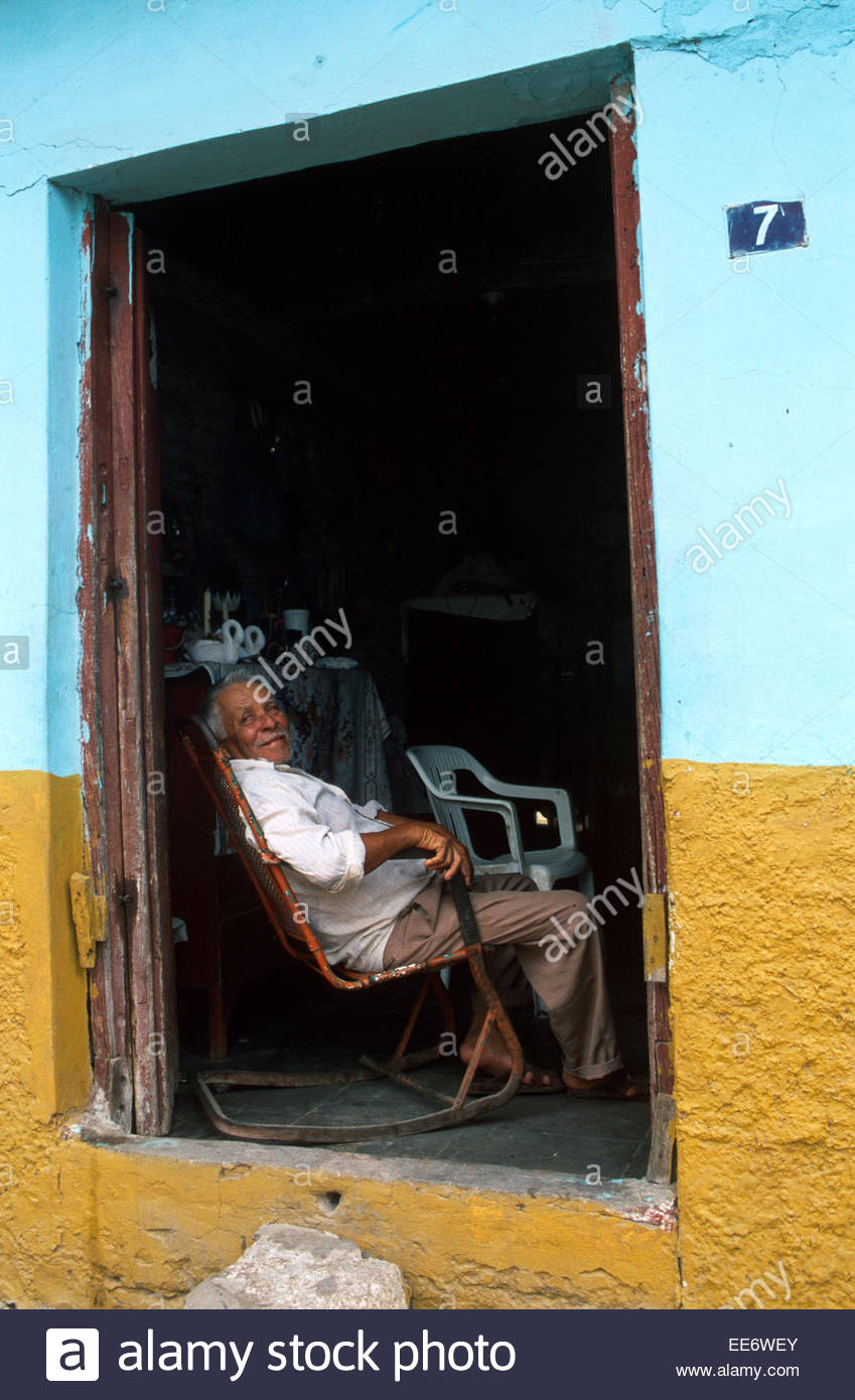 Mexcaltitan, A man sitting in the entrance to his home - Stock Image