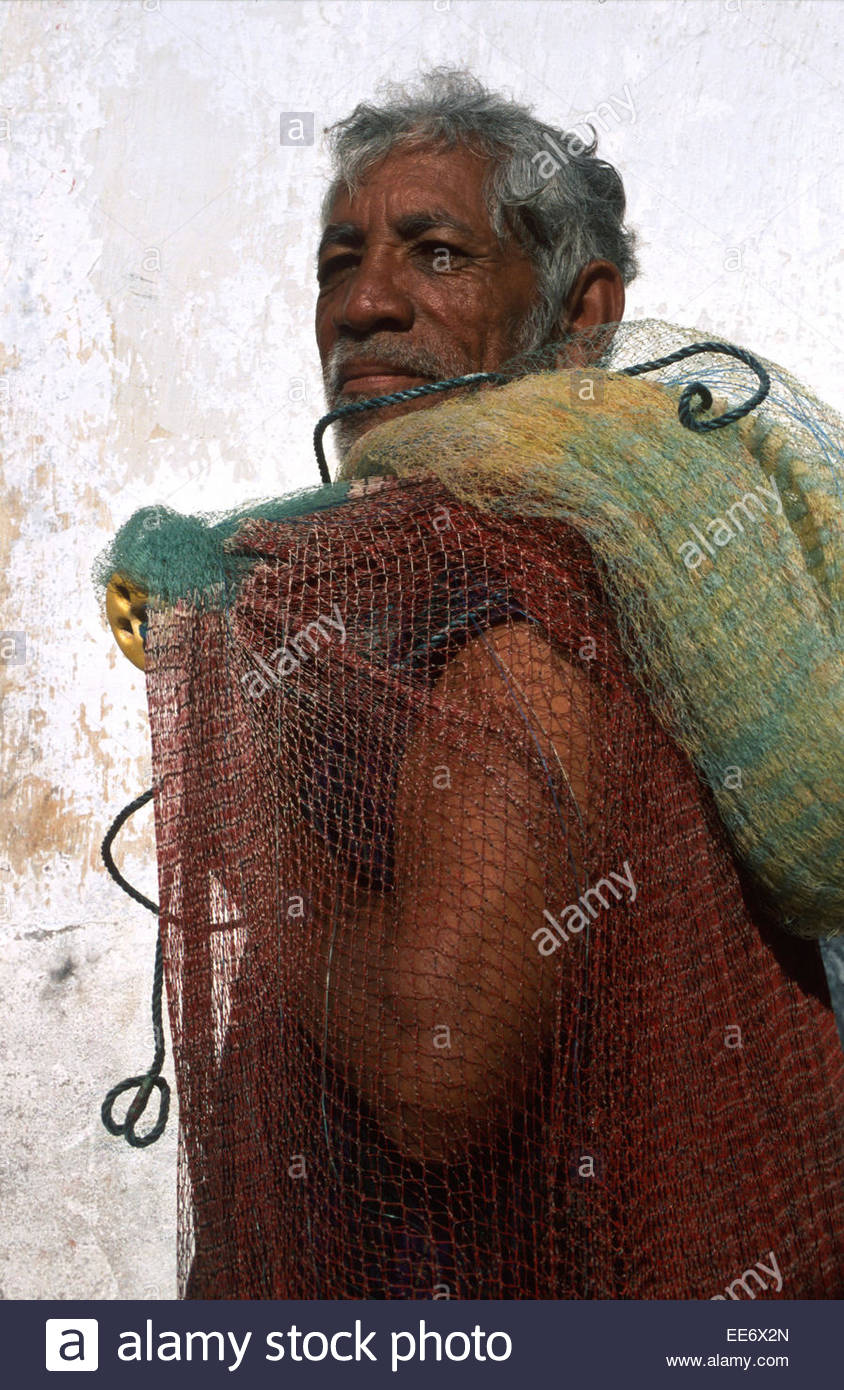 Mexcaltitan, A fisherman carrying his net - Stock Image