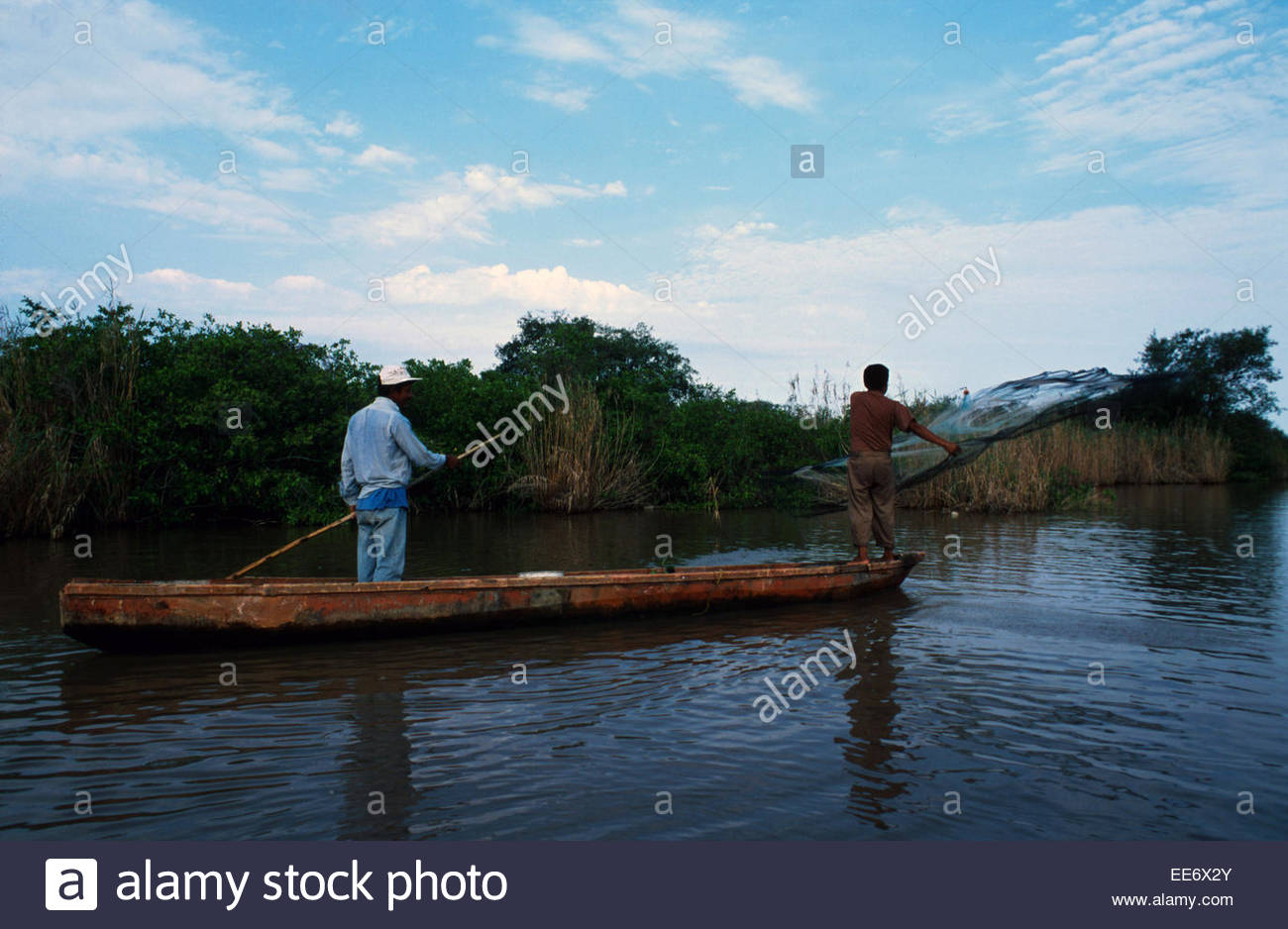 Mexcaltitan, fishermen fishing in the lagoon - Stock Image