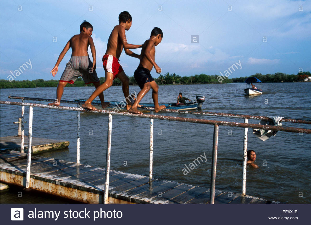Mexcaltitan, Children playing in the lagoon - Stock Image