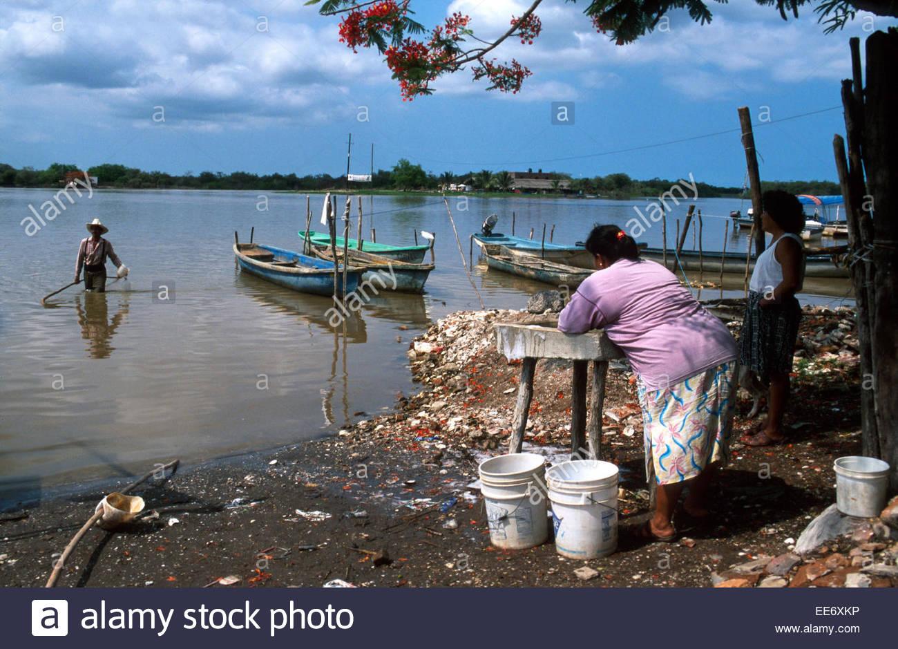 Mexcaltitan, Clothes washing in the lagoon Stock Photo
