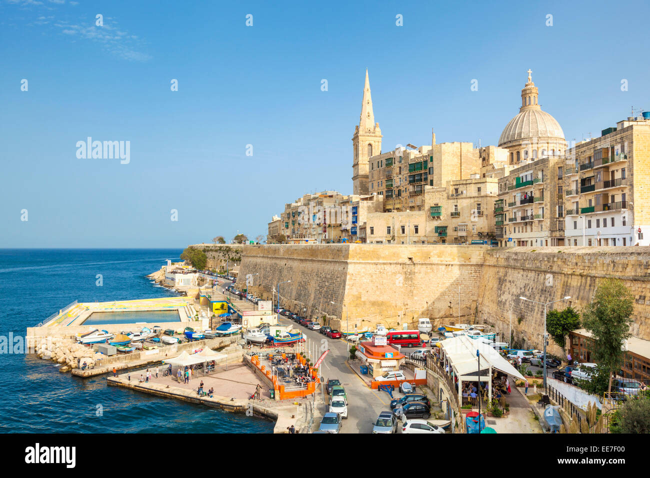 Valletta and Marsamxett Harbour with the Dome of the Carmelite Church and St Pauls Anglican Cathedral Valletta Malta - Stock Image