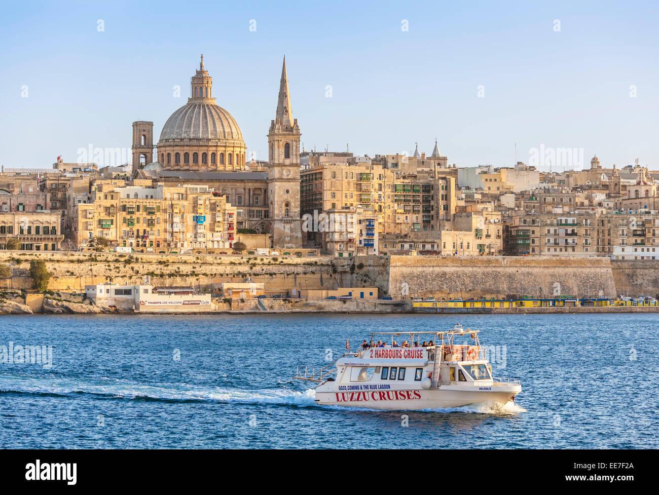 Valletta Skyline and Tourist Boat Marsamxett Harbour Valletta Malta EU Europe - Stock Image