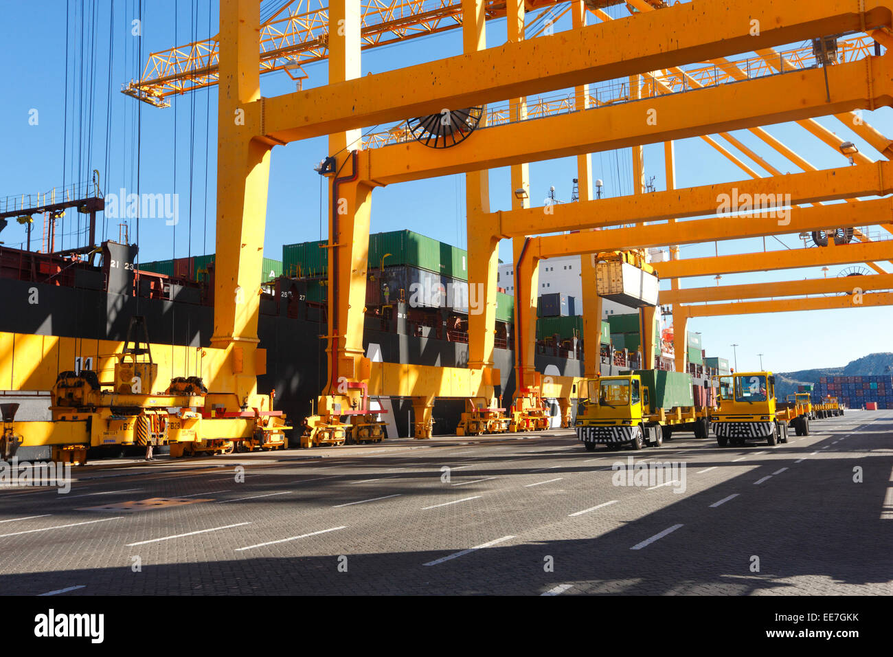 Unloading containers in Khor Fakkan commercial dock. - Stock Image