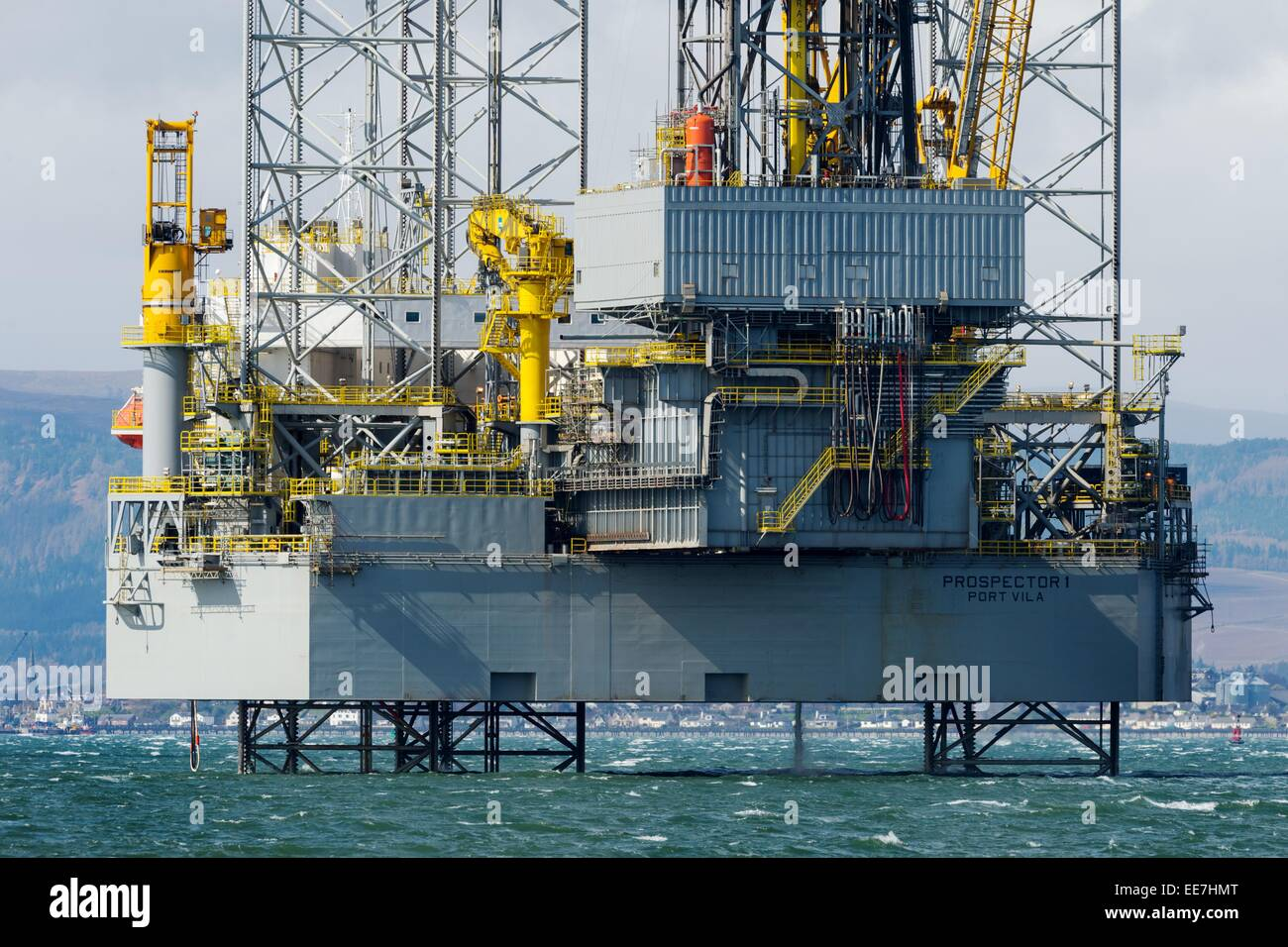 Offshore drilling rig Prospector 1 moored in the Cromarty Firth, Scotland, with the town of Invergordon in the background. - Stock Image