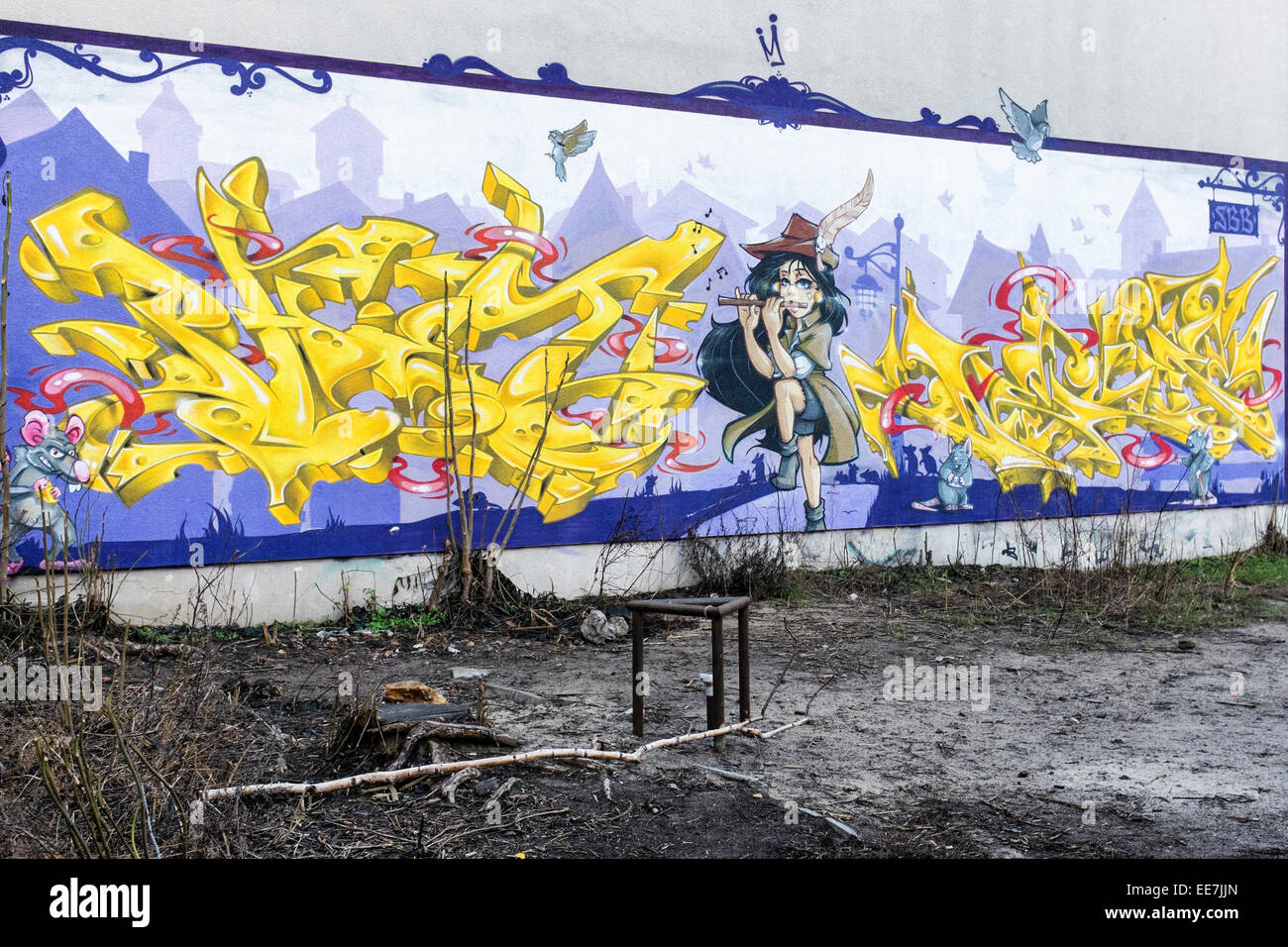 Berlin street art. Pied Piper and rats on an urban wall. Urban art and graffiti in Germany. - Stock Image