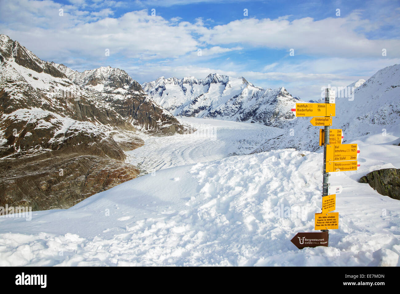 Signpost and view over the mountains in winter surrounding the Swiss Aletsch Glacier, largest glacier in the Alps, - Stock Image